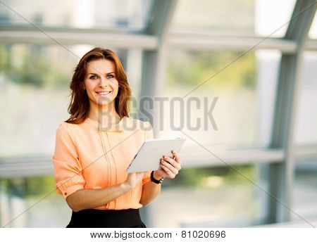 smiling business woman holding digital tablet computer