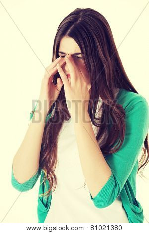 Young beautiful woman with sinus pressure pain.