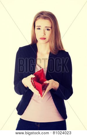 Worried business woman is showing her empty wallet.