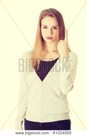 Beautiful woman is showing one finger in a warning.