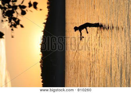 Lake fishing sunset
