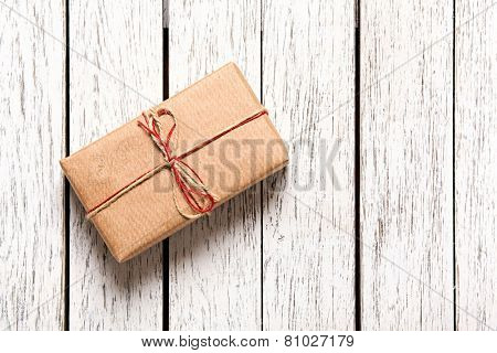 Gift box on white wood table. With a lot of copy space.
