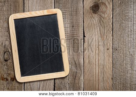 Blank Blackboard On Old Wooden Background