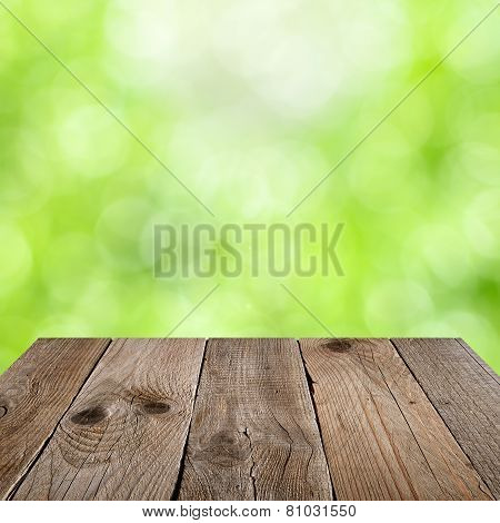 Wooden Table With Green Nature Bokeh Background