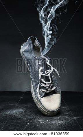 Old gym-shoe  in smoke