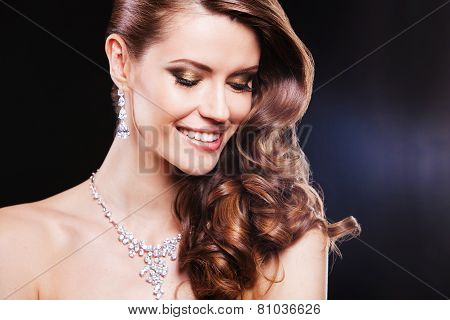 portrait of a beautiful happy brunette girl with luxury accessories. fashion model