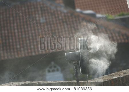 Fan Disperses Water Drops During The Heat