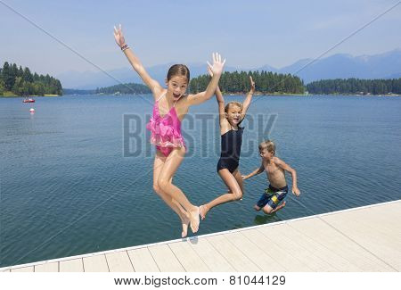 Kids playing at the lake on their summer vacation