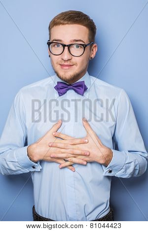 Humble young man with blue shirt and bow tie