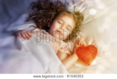 little girl sleeps in the bedroom