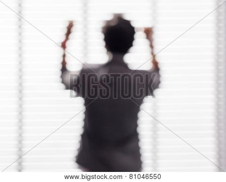 Blurred Picture Of Young Business Man Stands Near The Window With The Success Action.
