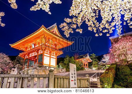 Kyoto, Japan at Kiyomizu-dera Shrine outter gate in the Spring illuminated at night. The Sign reads