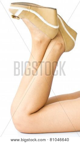 Young Woman Legs Wearing High Heels Isolated On White