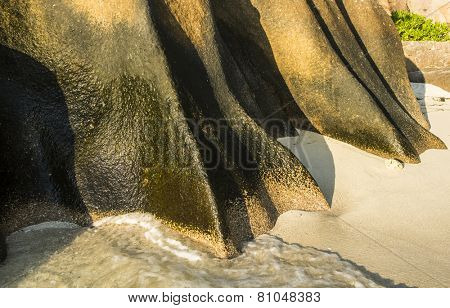 Beautifully shaped granite boulder in the sea of Seychelles at Anse Source d'Argent beach taken with a long exposure