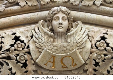 ZAGREB, CROATIA - SEPT 26: Angel on the portal of the cathedral dedicated to the Assumption of Mary and to kings Saint Stephen and Saint Ladislaus in Zagreb on Sept 26, 2013.