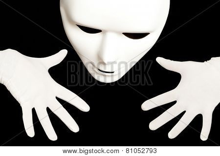 White theatrical mask isolated on black