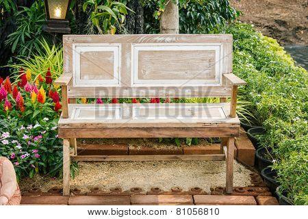 Wood Chair Furniture In A Beautiful Garden.