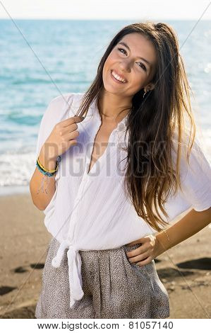 Pretty Long Hair Woman Posing At The Beach