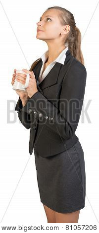 Businesswoman holding mug