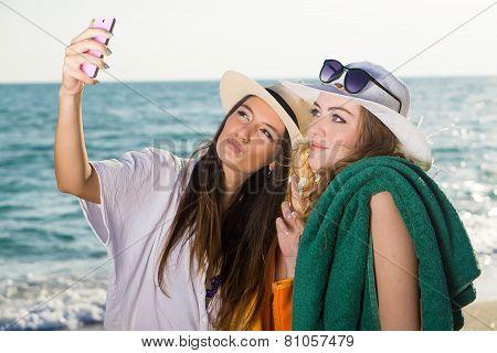 Pretty Women At The Beach Taking Selfie