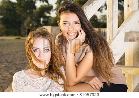 Attractive Young Women Sitting On Cottage Stairs