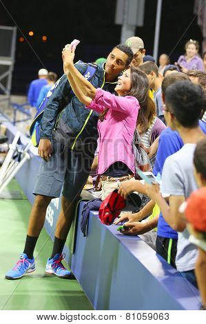 Professional tennis player Nick Kyrgios from Australia taking selfie with fan after win at US Open