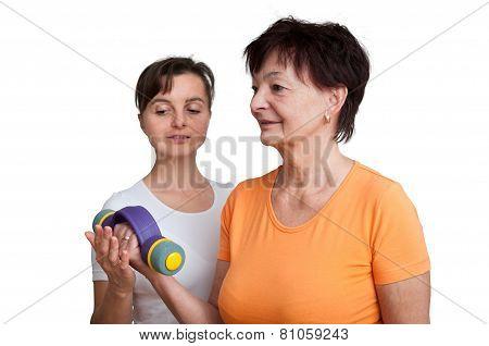 Coach assisting senior woman exercising