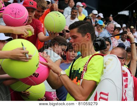 Professional tennis player Miols Raonic from Canada signing autographs after match at US Open 2014