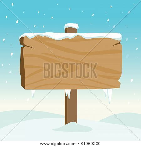 Blank wooden sign in the snow