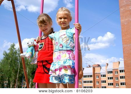 Girls on a swing