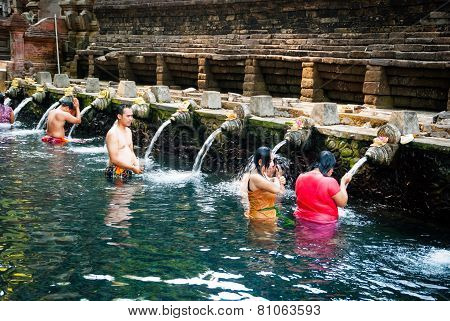People Washing At Pura Tirta Empul Temple, Bali, Indonesia
