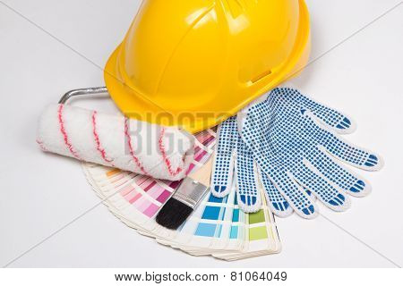 Painter's Tools - Brushes, Work Gloves, Yellow Helmet And Colorful Palette Over White