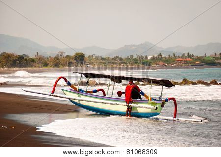 Typical Indoneisan Boats Called Jukung On The Beach Of Lovina, Bali