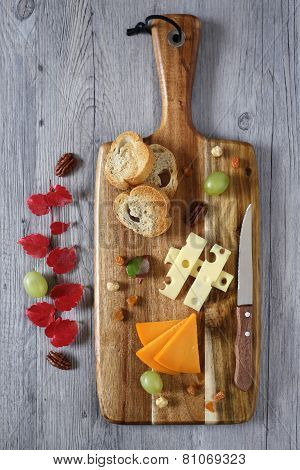Cheese Plate: Gouda Cheese, Green Grapes And Red Autumn Leaves
