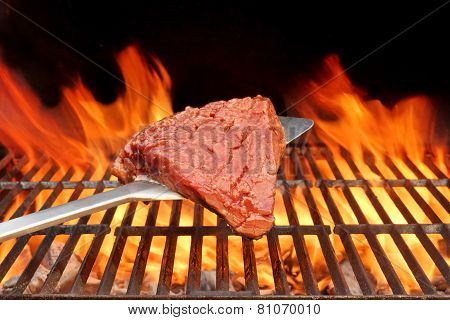Raw Beefsteak On The Blade Over A Hot Bbq Grill