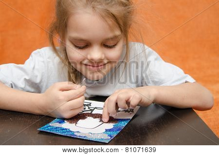 The Girl At The Table Playing Sand Applique