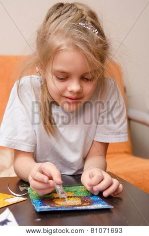 Five Year Old Girl Making Sand Applique