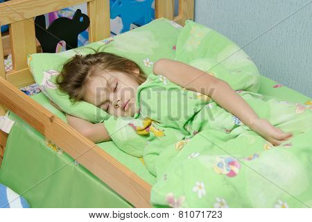 Six Year Old Girl Sleeping In Bed