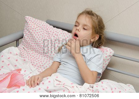 Diseased Girl Lying In Bed Coughing