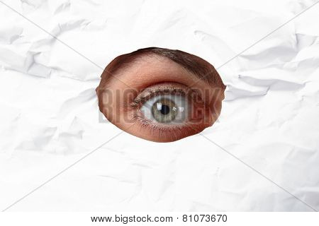 Eye Looking Through A Hole In A Paper