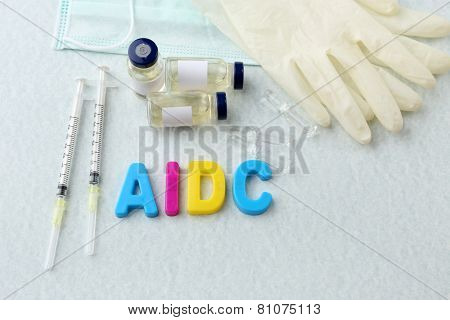 Medicines with word Aids on light background