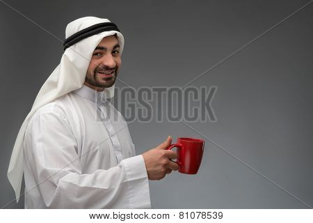 Happy Arab man having coffee break