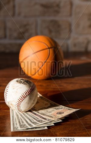 Baseball And Basketball With Dollars