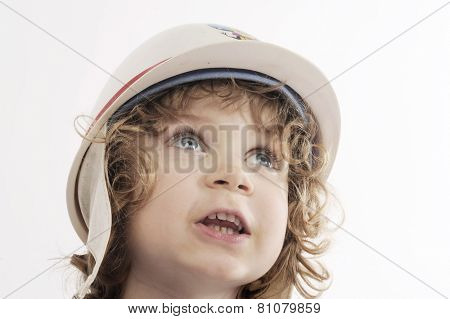 cute toddler boy with protect cap