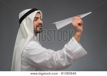 Arab businessman with paper airplane