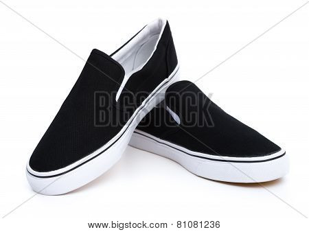 Pair Of Black Sneakers On White
