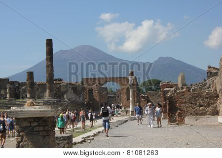 Temple Of Jupiter, Vesuvius Volcano and people in Pompei