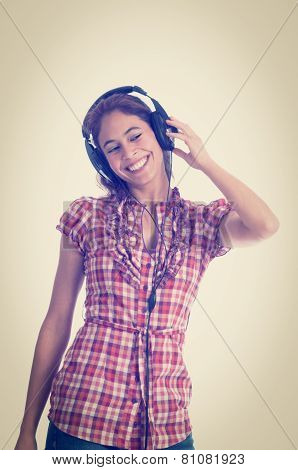 Beautiful Multi-ethnic Young Woman Listening To Music