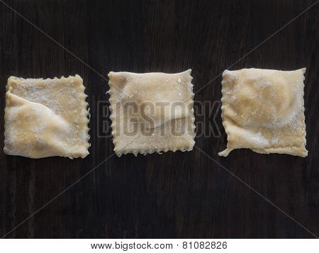 Fresh Ravioli With Flour On A Wooden Board