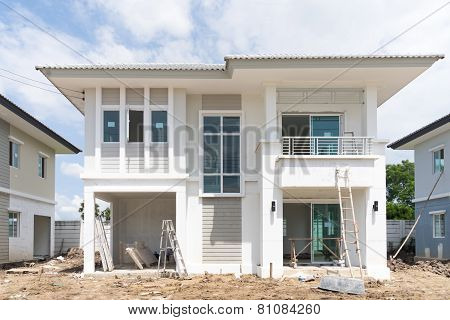 House Under Construction With Construction Equipment
